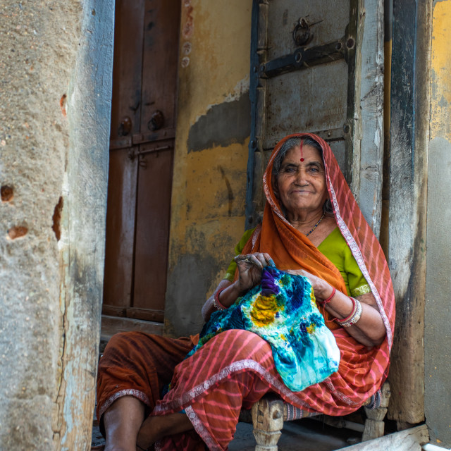 """Portrait of a rajasthani woman in traditional sari sewing, Rajasthan,..."" stock image"