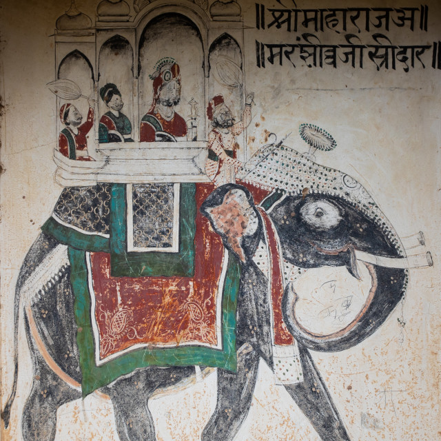 """Wall paintings depicting indian people riding an elephant on an old haveli,..."" stock image"