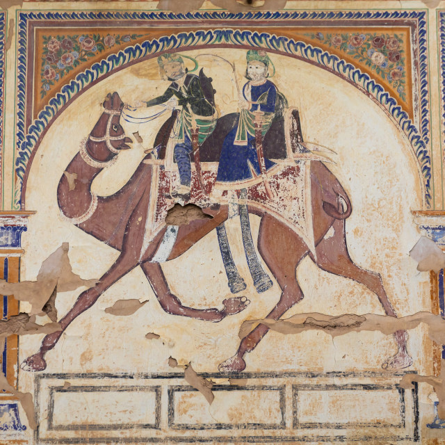 """Wall paintings depicting indian people riding a camel on an old haveli,..."" stock image"