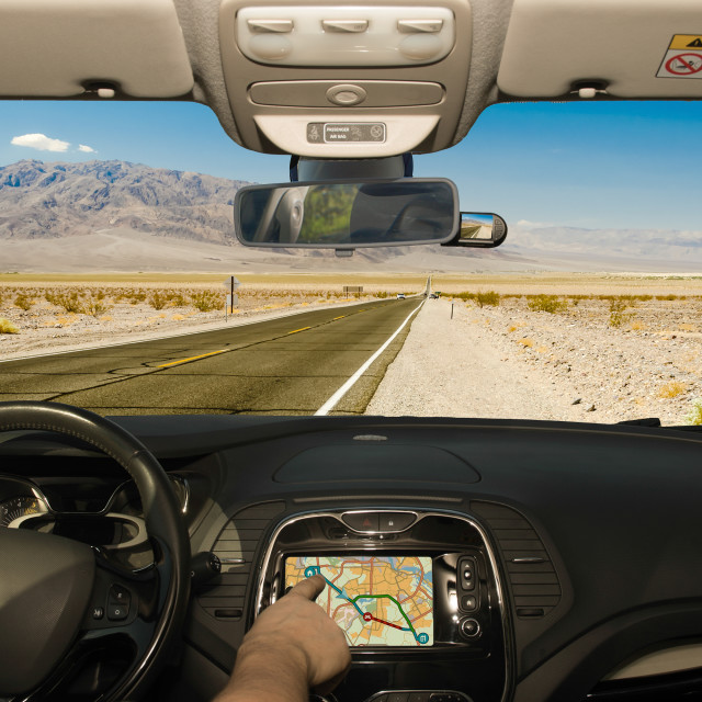 """""""Driving using GPS on a desert road, Death Valley, USA"""" stock image"""
