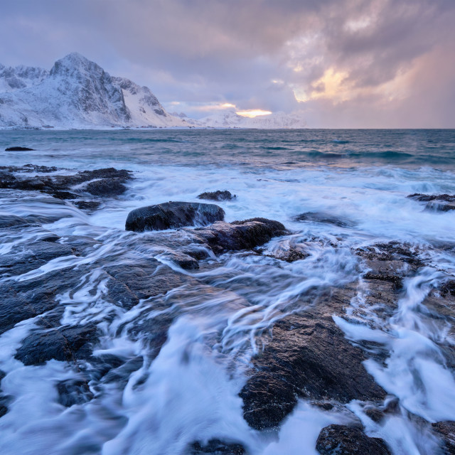 """Coast of Norwegian sea on rocky coast in fjord on sunset"" stock image"