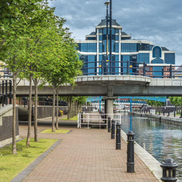 """""""Canal path and towering glass sided building at Salford Quay"""" stock image"""
