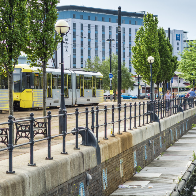 """""""A Tram passes by the docks at Salford Quay, Manchester."""" stock image"""