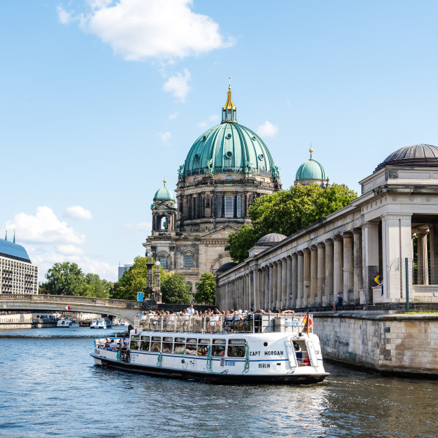 """Tour boat cruising by Spree river in Berlin"" stock image"