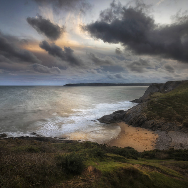 """Pobbles Bay and Three Cliffs"" stock image"