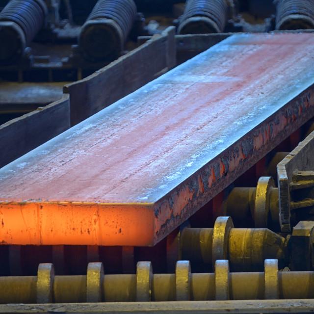 """Hot steel plate on conveyor"" stock image"