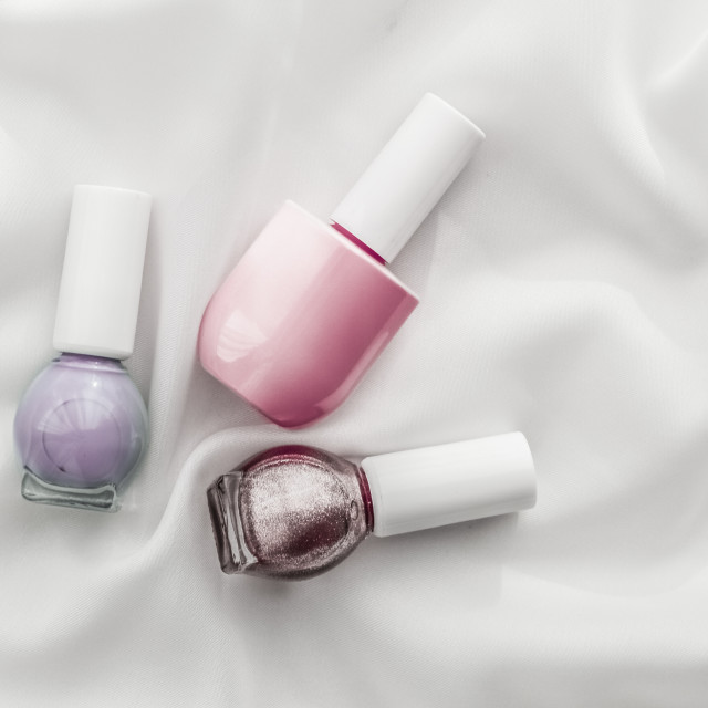 """""""Nail polish bottles on silk background, french manicure products and..."""" stock image"""