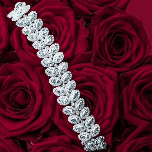 """""""Luxury diamond jewelry bracelet and red roses flowers, love gift on..."""" stock image"""