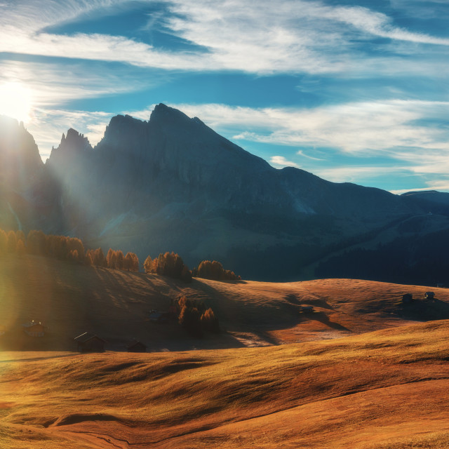 """""""Autumn sunrise scenery with yellow larches and small alpine buil"""" stock image"""