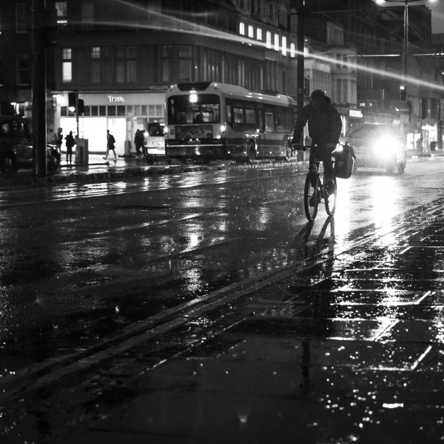 """Cycling in the Rain"" stock image"