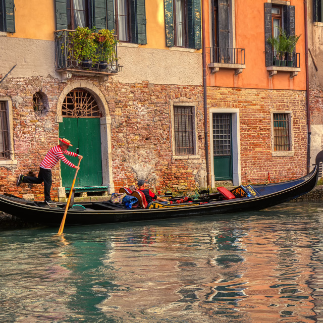 """Tourists travel on gondola at canal in Venice, Italy."" stock image"