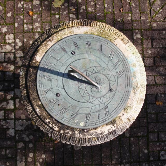 """Horizontal garden sundial top down"" stock image"