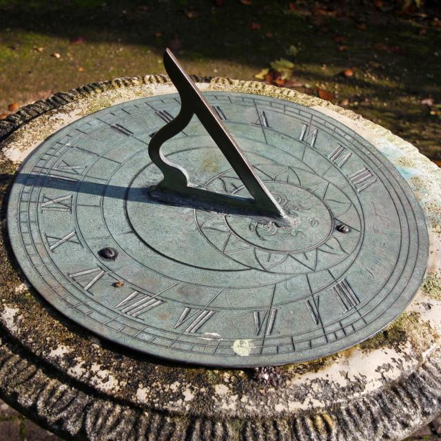 """Horizontal garden sundial"" stock image"