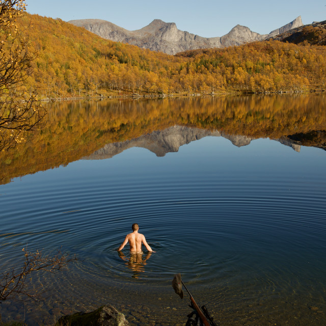 """Moose hunter taking going for a swim"" stock image"