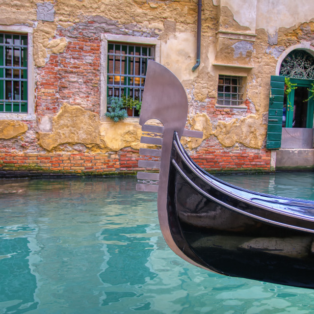 """Gondola sailing through a canal in Venice."" stock image"