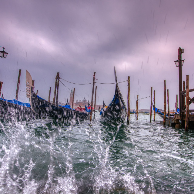 """Gondolas parked at San Marco square with high tide."" stock image"