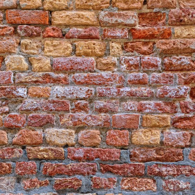 """Red brick wall with saltpeter and moisture."" stock image"
