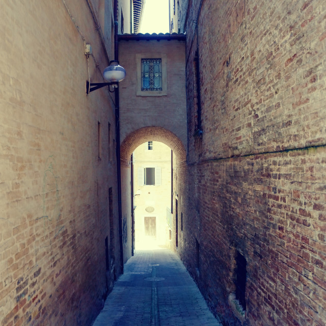 """Narrow street in Urbino town in Italy"" stock image"