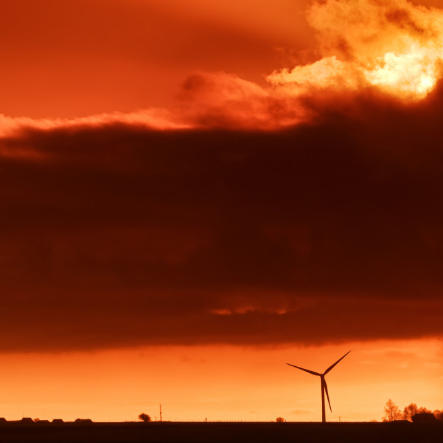 """Wind turbine sunrise"" stock image"