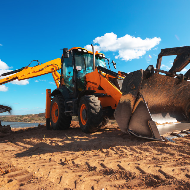 """""""Wheel loader excavator with field background during earthmoving"""" stock image"""