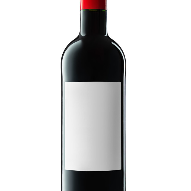 """""""Wine bottle with label and red wine isolated on white background with clipping path."""" stock image"""