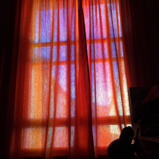 """Closed orange bedroom curtains"" stock image"