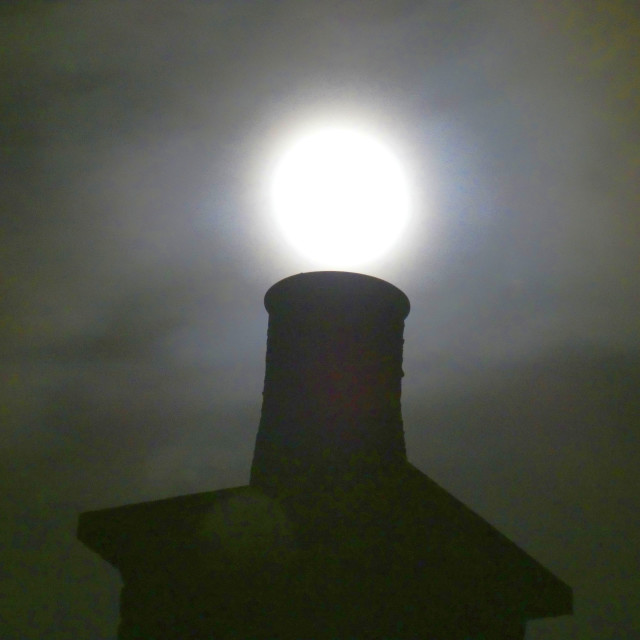"""Supermoon falling into a chimney!"" stock image"