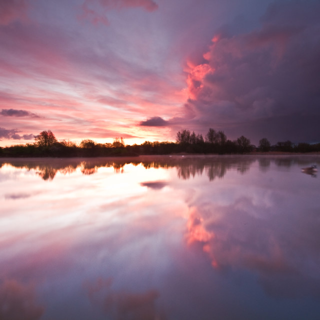 """Storm cloud heading over Shinewater park lake"" stock image"