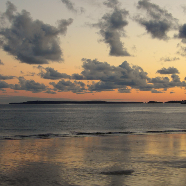 """""""Caldey Island and Tenby from Amroth"""" stock image"""