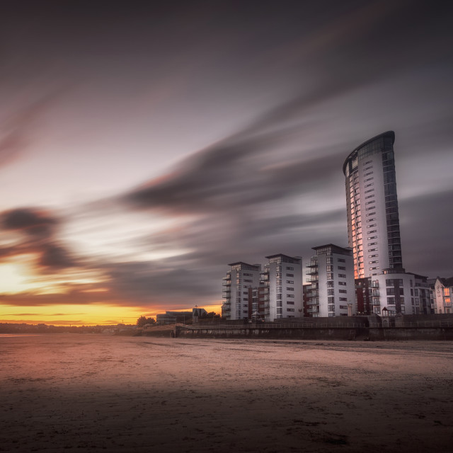 """Sweeping clouds sunset on Swansea Bay"" stock image"