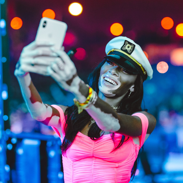 """Winnie Harlow pictured taking a selfie at Ultra Music Festival"" stock image"