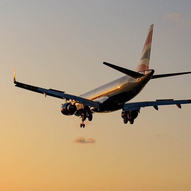 """Airbus neo landing at sunset"" stock image"