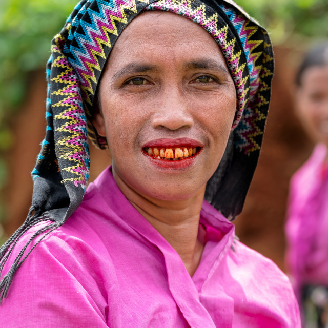 """""""A Manggarai women eating betal nut which causes reddening of the tongue and..."""" stock image"""