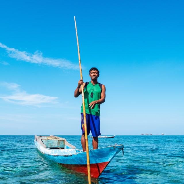 """Portrait Bajau Fisherman scouring the ocean, Togian Islands, Indonesia."" stock image"