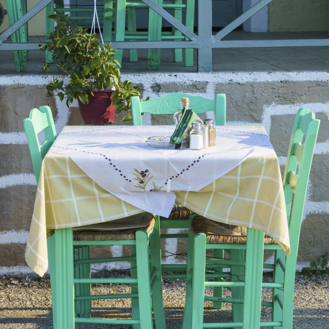 """Taverna table and chairs, Gaios, Paxos, Ionian Islands, Greece"" stock image"