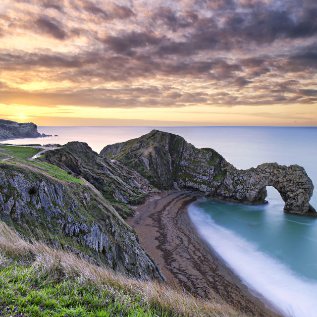 """Durdle Door Sunrise"" stock image"