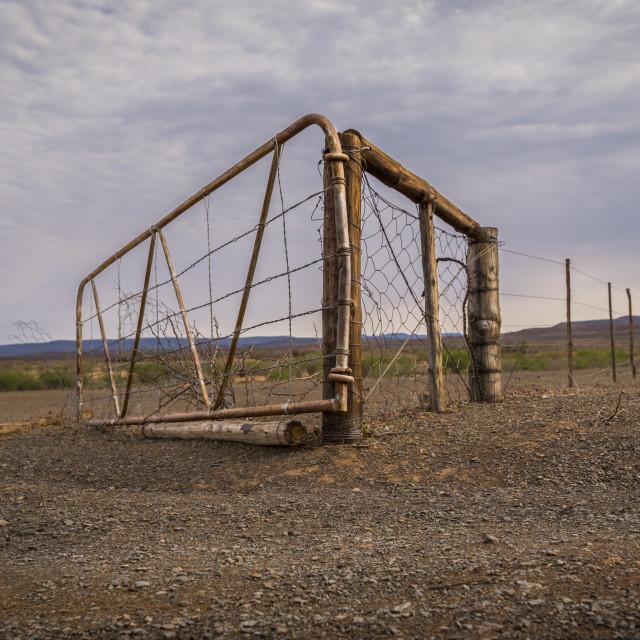"""""""Arrid landscape. Broken gate"""" stock image"""
