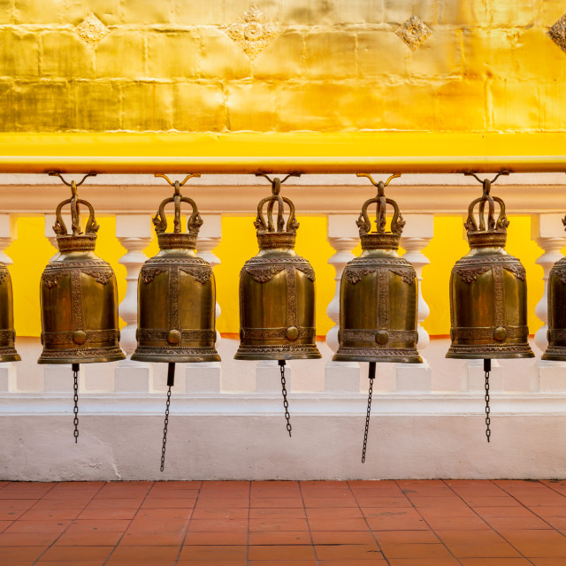 """Prayer bells in a Thai Buddhist temple"" stock image"