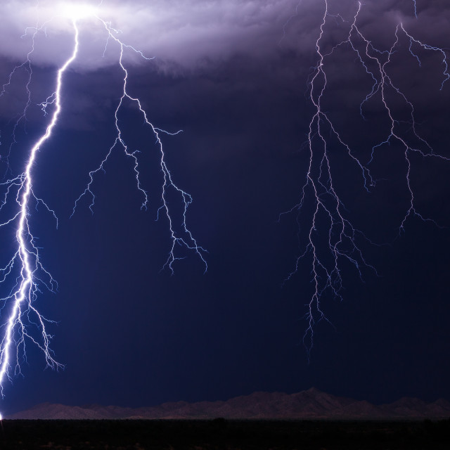 """Lightning bolt strike from a thunderstorm"" stock image"