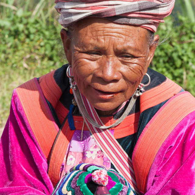 """""""Lisu woman in traditional dress selling hilltribe hats in Mae Hong Son, Thailand"""" stock image"""