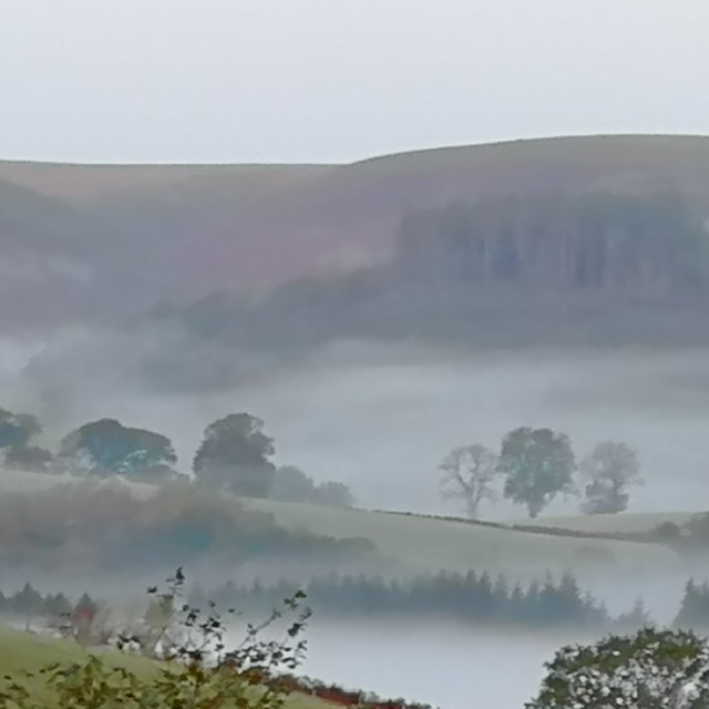 """Wales valleys in the mist"" stock image"
