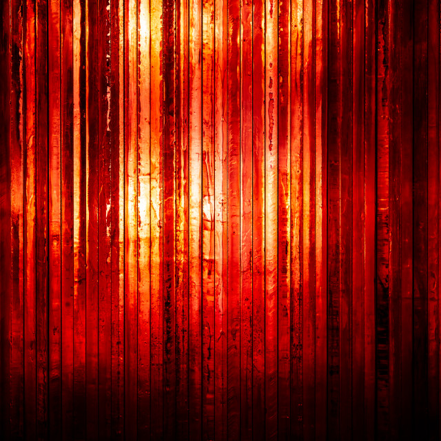"""""""Thick bright red glass with light shining through from the back"""" stock image"""