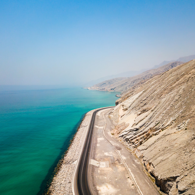 """""""Coastal road and seaside in Musandam Governorate of Oman aerial"""" stock image"""