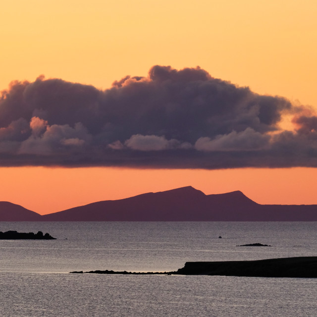 """Sunset And Cloud Over Foula, Shetland."" stock image"