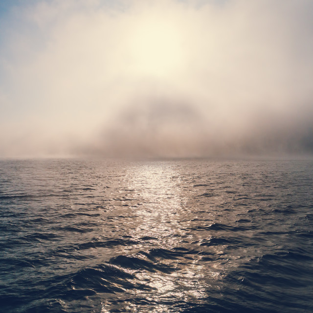 """Sea sunrise and foggy morning. Fog above blue ripple water, aeri"" stock image"