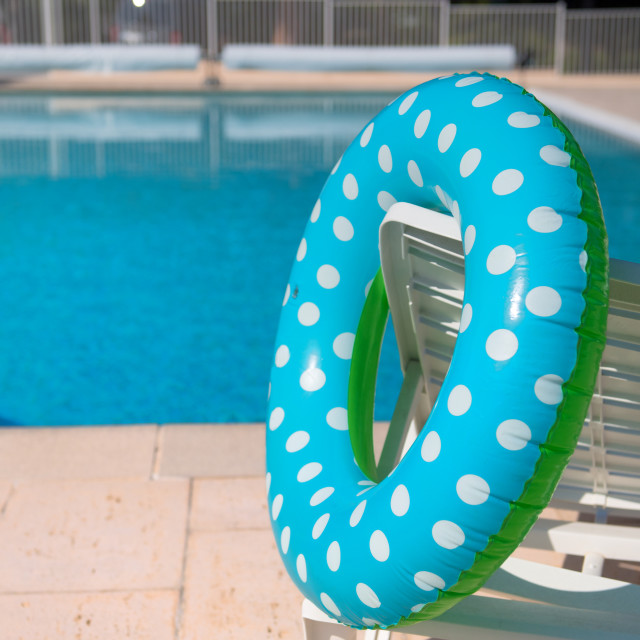 """Pool with inflatable blue ring"" stock image"