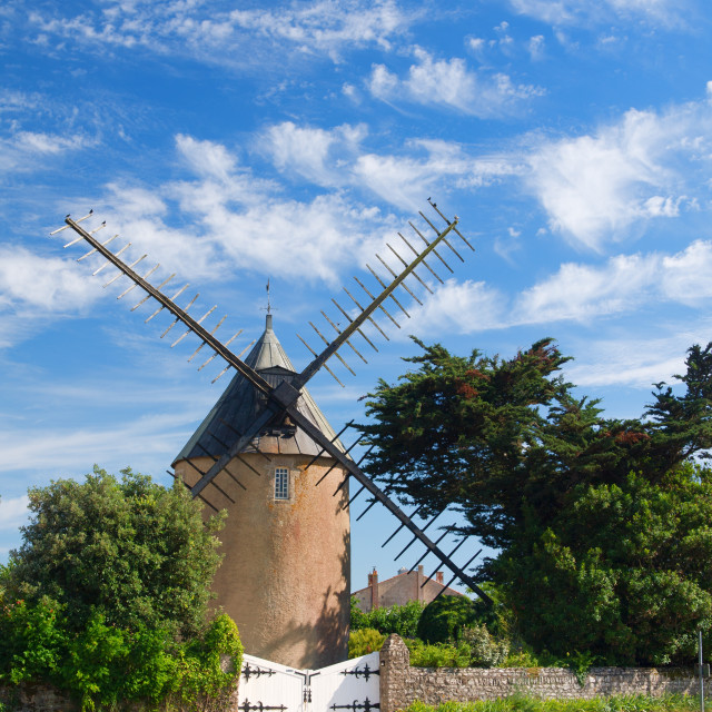 """Old windmill on French island"" stock image"