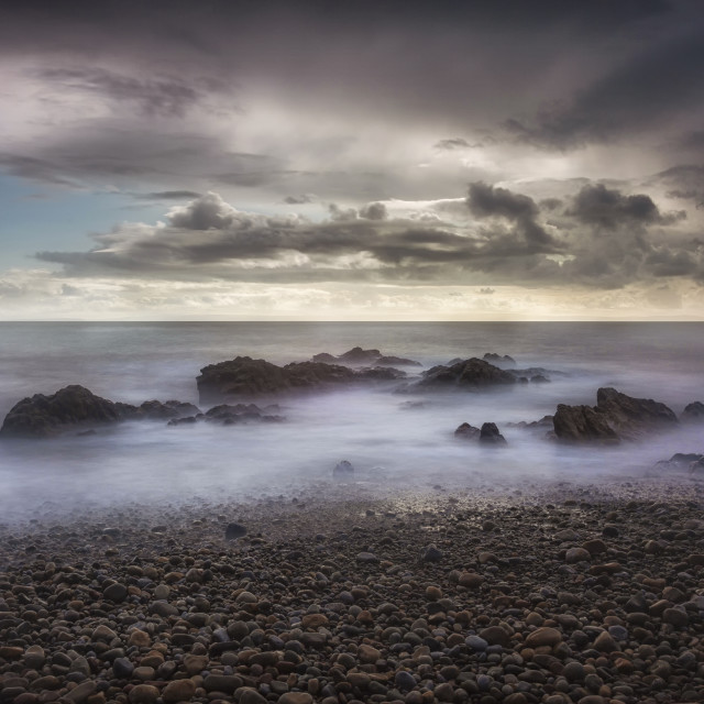 """Stormy weather over Bracelet Bay"" stock image"