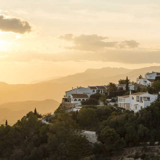 """View of spanish villas white washed village of Mijas Pueblo, at sunset in Southern Spain, Andalusia."" stock image"