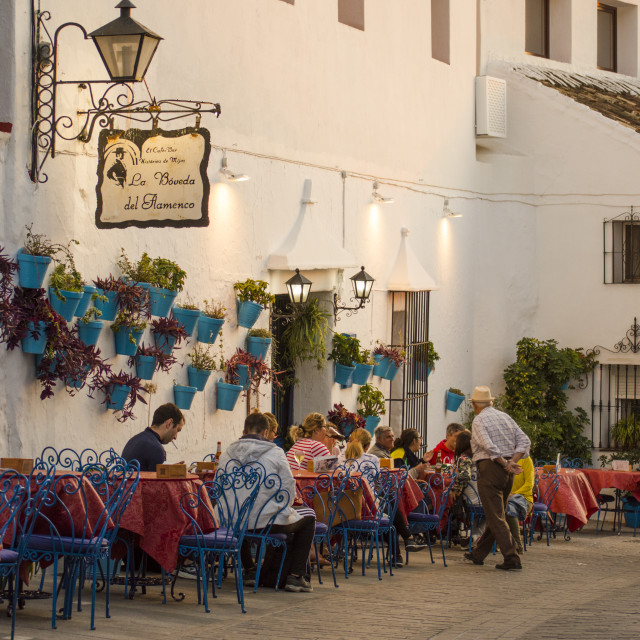 """Terrace of la boveda del Flamenco in the white village of Mijas in Malaga with people drinking. Costa del Sol, Andalusia, Spain."" stock image"